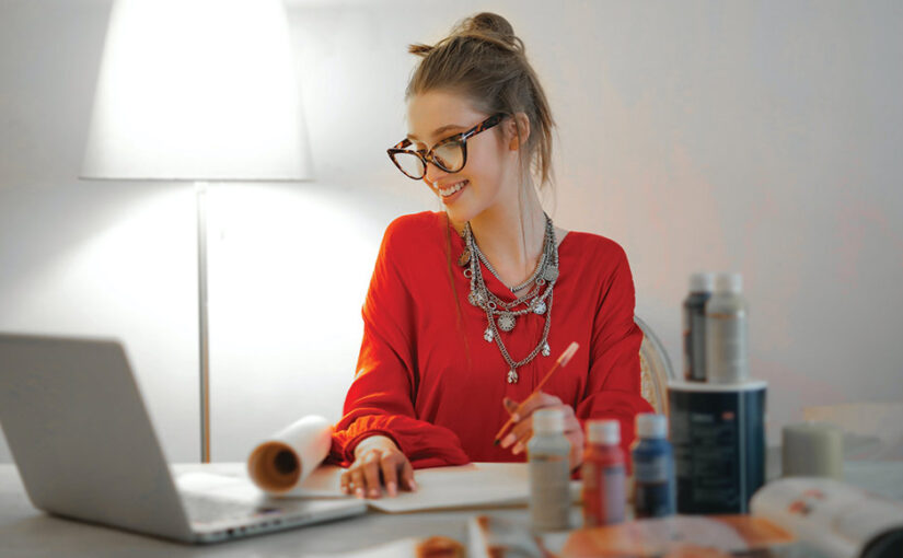 Woman working on SEO Red Orbit blog